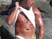 Gay hunk is very hard on the beach