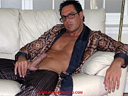 Big gay stud inserts his butt plug while masturbating