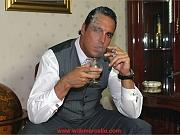 Classy cigar smoking stud spunks all over his brandy glass