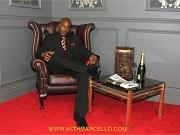 Gay black hunk enjoys cigar before having a big wank