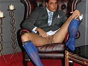 Swarve gay hunk in suit shoots his load onto leather armchair