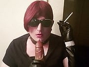 Sissy smoking and practicing sucking cock in leather gloves